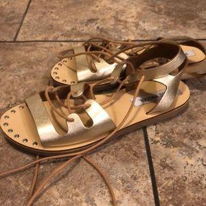 Gold tie up gladiator sandals